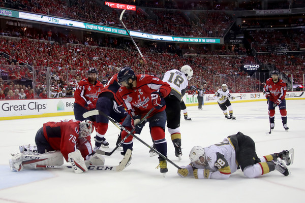 2018 NHL Stanley Cup Final - Game Four [player,college ice hockey,sports,ice hockey,hockey protective equipment,ice hockey position,team sport,sports gear,ball game,hockey,nate schmidt 88,braden holtby 70,alex ovechkin,four,shot,capital one arena,nhl,washington capitals,vegas golden knights,stanley cup final]