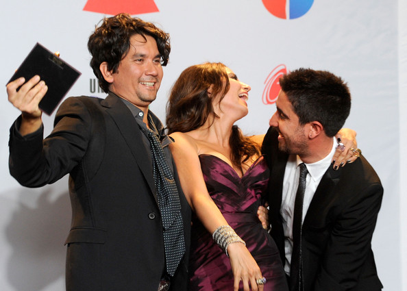 The 12th Annual Latin GRAMMY Awards - Press Room [best pop album,event,fun,white-collar worker,formal wear,photography,premiere,gesture,suit,conversation,style,jorge villamizar,lena burke,alex jorge y lena,alex ubago,l-r,room,band,a duo/group with vocals award,latin grammy awards]