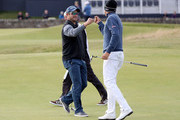 Christaan Bezuidenhout of South Africa reacts with Mark Boucher after holing putt on the first green during the first round of the Alfred Dunhill Links Championship at The Old Course on October 6, 2016 in St Andrews, Scotland.