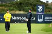 Shane Warne plays off the 16th tee watched by Mark Boucher during the second round of the 2014 Alfred Dunhill Links Championship at the Championship Links at Carnoustie on October 3, 2014 in Carnoustie, Scotland.