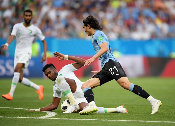 Uruguay Vs. Saudi Arabia: Group A - 2018 FIFA World Cup Russia [player,sports,sports equipment,football player,team sport,ball game,sport venue,football,soccer player,soccer,edinson cavani,ali albulayhi,saudi arabia,russia,uruguay,rostov-on-don,rostov arena,group,group a - 2018 fifa world cup,match]