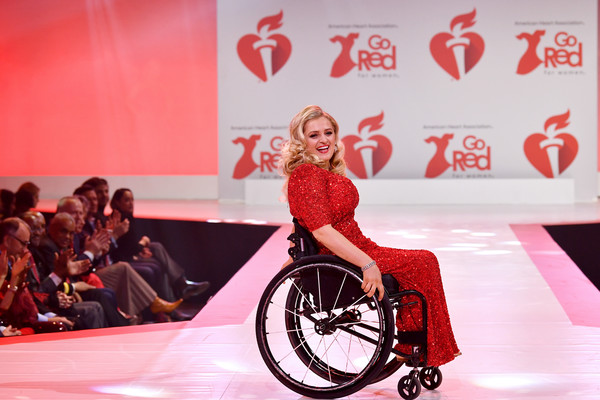 The American Heart Association's Go Red For Women Red Dress Collection 2020 - Runway [red,fashion,wheelchair,lip,vehicle,event,performance,american heart associations go red for women red dress collection 2020 - runway,the american heart associations go red for women red dress collection,runway,hammerstein ballroom,new york city,nicky hilton rothschild,go red for women,go red for women,go red,red dress collection,celebrity,fashion,2020,ali stroker]