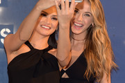 (L-R) Miss Universe 2015 Pia Wurtzbach and Miss USA 2015 Olivia Jordan pose for a selfie at the Alice + Olivia By Stacey Bendet - Arrivals at The Gallery, Skylight at Clarkson Sq on February 16, 2016 in New York City.
