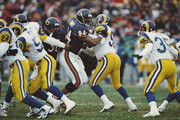 John Thierry #94 Defensive End for the Chicago Bears blocks Robert Jones #55 of the Los Angeles Ramsduring the National Football Conference Central game against the Los Angeles Rams on 8 December 1996 at Soldier Field, Chicago, Illinois, United States. The Bears won the game 35 - 9.