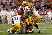 Jordan Jefferson #9 of the Louisiana State University Tigers gets sacked in the fourth quarter by Trey Depriest #33 of the Alabama Crimson Tide during the 2012 Allstate BCS National Championship Game at Mercedes-Benz Superdome on January 9, 2012 in New Orleans, Louisiana.