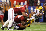 Jordan Jefferson #9 of the Louisiana State University Tigers is sacked late in the second quarter by the Alabama Crimson Tide during the 2012 Allstate BCS National Championship Game at Mercedes-Benz Superdome on January 9, 2012 in New Orleans, Louisiana.