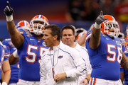 Head coach Urban Meyer of the Florida Gators stands on the field before the Allstate Sugar Bowl against the Cincinnati Bearcats at the Louisana Superdome on January 1, 2010 in New Orleans, Louisiana.
