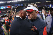 (L-R) .Head coach Mike Gundy of the Oklahoma State Cowboys congratulates head coach Hugh Freeze of the Mississippi Rebels  on their 48-20 win during the Allstate Sugar Bowl at Mercedes-Benz Superdome on January 1, 2016 in New Orleans, Louisiana.