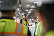 Fiore & Sons contractors employee Mike Kelly of Denver, Colorado speaks during a tour of a new Amazon Fulfillment Center on April 14, 2016 in Aurora, Co. The one-million square foot center, the first such facility in the state, will create more than 1,000 full-time jobs according to Amazon and is expected to be up and running later this year.