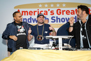 """(L-R) Founder & CEO of Goldbelly, Joe Ariel, Nick Gordon and Adam Richman celebrate the winning sandwich """"The Bomb"""" by Sal, Kris and Charlie's Deli at America's Greatest Sandwich Showdown during New York City Wine & Food Festival at Highline Stages on October 13, 2019 in New York City."""