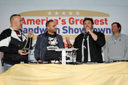 (2nd from L) Founder & CEO of Goldbelly, Adam Richman and Frank Luciano attend America's Greatest Sandwich Showdown during New York City Wine & Food Festival at Highline Stages on October 13, 2019 in New York City.