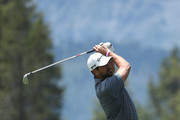NFL athlete Aaron Rodgers of the Green Bay Packers plays his second shot on the third hole during round one of the American Century Championship at Edgewood Tahoe South golf course on July 10, 2020 in Lake Tahoe, Nevada.