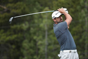 NFL athlete Aaron Rodgers of the Green Bay Packers plays a tee shot on the 18th hole during round one of the American Century Championship at Edgewood Tahoe South golf course on July 10, 2020 in Lake Tahoe, Nevada.