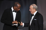 Actor Sidney Poitier (L) and writer George Stevens Jr. speak onstage during American Film Institute's 45th Life Achievement Award Gala Tribute to Diane Keaton at Dolby Theatre on June 8, 2017 in Hollywood, California. 26658_007