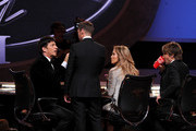 """(L-R) American Idol Judges Harry Connick, Jr., host Ryan Seacrest, Jennifer Lopez, and Keith Urban onstage during Fox's """"American Idol"""" XIII Finale at Nokia Theatre L.A. Live on May 21, 2014 in Los Angeles, California."""