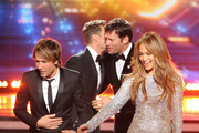 """(L-R) American Idol Judge Keith Urban, host Ryan Seacrest, judges Harry Connick Jr., and Jennifer Lopez speak onstage during Fox's """"American Idol"""" XIII Finale at Nokia Theatre L.A. Live on May 21, 2014 in Los Angeles, California."""
