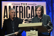 Ken Paulson and Jackson Browne speak onstage at the 13th annual Americana Music Association Honors and Awards Show at the Ryman Auditorium on September 17, 2014 in Nashville, Tennessee.