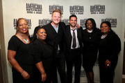 The McCrary Sisters' Ann and Deborah McCrary, The Lone Bellow's Brian Elmquist and Zach Williams, and the McCrary Sisters' Alfreda and Regina McCrary backstage at the 14th annual Americana Music Association Honors and Awards Show at the Ryman Auditorium on September 16, 2015 in Nashville, Tennessee.