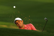 Francesco Molinari of Italy plays a shot from a bunker on the first hole in his match against Paul Casey of England during the fourth round of the World Golf Championships-Dell Technologies Match Play at Austin Country Club on March 30, 2019 in Austin, Texas.
