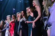 (L-R) Marjan Jonkman, Eniko Mihalik, Daphne Groeneveld, Dewi Driegen, Alessandra Ambrosio, Karolina Kurkova, Carine Roitfeld, Natasha Poly and Hannah Ferguson on stage at the amfAR Gala Cannes 2018 at Hotel du Cap-Eden-Roc on May 17, 2018 in Cap d'Antibes, France.