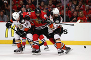 Simon Despres #24 and Andrew Cogliano #7 of the Anaheim Ducks battle with Antoine Vermette #80 of the Chicago Blackhawks for a loose puck in Game Four of the Western Conference Finals during the 2015 NHL Stanley Cup Playoffs at the United Center on May 23, 2015 in Chicago, Illinois.