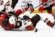 Tommy Wingels #57 of the Chicago Blackhawks and Hampus Lindholm #47 of the Anaheim Ducks in the ice in front of the goal at the United Center on February 15, 2018 in Chicago, Illinois. The Ducks defeated the Blackhawks 3-2.