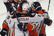 David Perron #57 of the Anaheim Ducks hugs teammate Ryan Getzlaf #15 after Getzlaf scored the game-winning goal against the Chicago Blackhawks in overtime at the United Center on February 13, 2016 in Chicago, Illinois. The Ducks defeated the Blackhawks 3-2 in overtime.