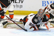 John Gibson #36 of the Anaheim Ducks sprawls to smother the puck against the Chicago Blackhawks at the United Center on October23, 2018 in Chicago, Illinois.