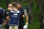 Lee Westwood of England hugs his son and caddie Sam on the 18th green during the completion of the weather affected second round of the Andalucia Valderrama Masters at Real Club Valderrama on October 20, 2018 in Cadiz, Spain.
