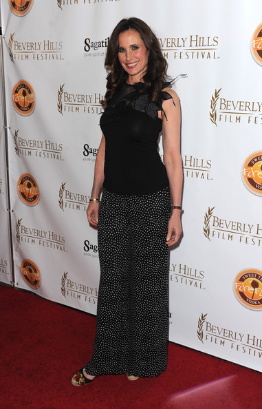 10th Annual Beverly Hills Film Festival Opening Night - Arrivals [andie macdowell,clothing,dress,red carpet,carpet,premiere,fashion,shoulder,flooring,long hair,little black dress,10th annual beverly hills film festival opening night - arrivals,10th annual beverly hills film festival opening night,beverly hills,california,clarity theater]