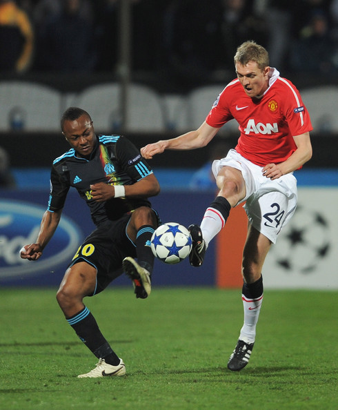 Andre Ayew Darren Fletcher of Manchester United challenges Andre Ayew of Marseille during the UEFA Champions League round of 16 first leg match between Marseille and Manchester United at the Stade Velodrome on February 23, 2011 in Marseille, France.