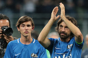 Andrea Pirlo greets the fans with his son at the end of Andrea Pirlo Farewell Match at Stadio Giuseppe Meazza on May 21, 2018 in Milan, Italy.