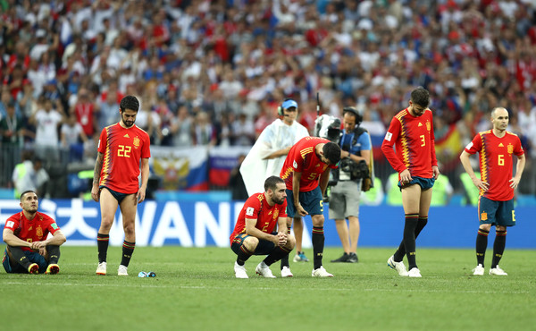 Spain vs. Russia: Round of 16 - 2018 FIFA World Cup Russia [player,sports,sport venue,team sport,ball game,football player,soccer player,team,soccer,stadium,players,russia,luzhniki stadium,moscow,spain,round,2018 fifa world cup,match]