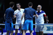 Winnes, Mansour Bahrami and Tim Henman shake hands with Jamie Murray and Andy Murray during Andy Murray Live at The Hydro on November 7, 2017 in Glasgow, Scotland.