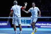 Mansour Bahrami and Tim Henman celebrate victory over Andy Murray and Jamie Murray during Andy Murray Live at The Hydro on November 7, 2017 in Glasgow, Scotland.