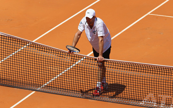 Andy Roddick Andy Roddick of the USA shows his dejection as he leans on the net during his first round match against Gilles Simon of France during day two of the Internazoinali BNL D'Italia at the Foro Italico Tennis Centre on May 9, 2011 in Rome, Italy.
