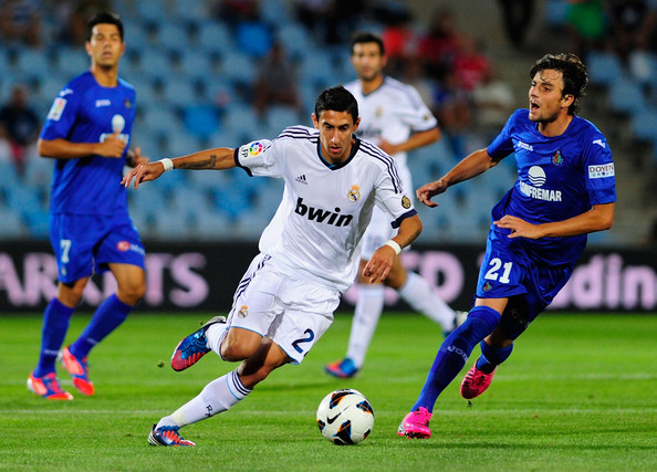 Real Madrid Vs Getafe 2012: Angel Di Maria And Michel Photos Photos