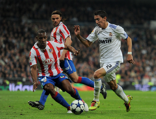 Angel Di Maria Luis Perea (L) of Atletico Madrid duels fot the ball with Angel Di Maria of Real Madrid during the quarter-final Copa del Rey first leg match between Real Madrid and Atletico Madrid at Estadio Santiago Bernabeu on January 13, 2011 in Madrid, Spain.