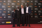 (L-R) Actors Kenny Nzogang, Jean-Baptiste Tiemele, director Markus Schleinzer and actor Makita Samba  attend the 'Angelo' photocall during the 66th San Sebastian International Film Festival on September 25, 2018 in San Sebastian, Spain.