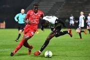 Montpellier's French defender Nordi Mukiele (L) fights for the ball with Angers' French forward Gilles Sunu (R) during the French L1 football match between Angers (SCO) and Montpellier (MHSCFOOT) at the Raymond-Kopa Stadium, in Angers, northwestern France on December 9, 2017. / AFP PHOTO / JEAN-FRANCOIS MONIER