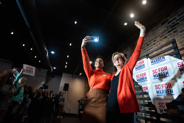 Presidential Candidate Elizabeth Warren Campaigns In South Carolina Ahead Of Primary [fan,event,crowd,competition event,night,games,elizabeth warren campaigns in south carolina ahead of primary,elizabeth warren,anika noni rose,crowd,selfie,south carolina,greenville,democratic,canvassing kickoff event,primary,indoor games and sports,world,championship,product,crowd]
