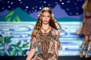 Model Ondria Hardin walks the runway at the Anna Sui fashion show during Mercedes-Benz Fashion Week Spring 2014 at The Theatre at Lincoln Center on September 11, 2013 in New York City.