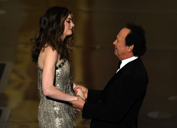 Anne Hathaway Host Anne Hathaway greets Billy Crystal onstage during the 83rd Annual Academy Awards held at the Kodak Theatre on February 27, 2011 in Hollywood, California.