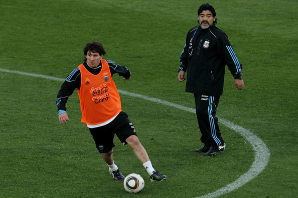 Argentina's head coach Diego Maradona watches on as Lionel Messi looks to pass during a team training session on June 6, 2010 in Pretoria, South Africa.