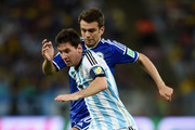 Lionel Messi Emir Spahic Photos Photo
