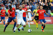 Sergio Aguero of Argentina fights for the ball with Jean Beausejour of Chile during the Copa America Brazil 2019 Third Place match between Argentina and Chile at Arena Corinthians on July 06, 2019 in Sao Paulo, Brazil.