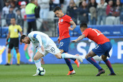 Lionel Messi of Argentina fights for the ball with Charles Aranguiz and Erick Pulgar of Chile during the Copa America Brazil 2019 Third Place match between Argentina and Chile at Arena Corinthians on July 06, 2019 in Sao Paulo, Brazil.