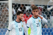 Paulo Dybala of Argentina celebrates after scoring the second goal of his team with teammate Lionel Messi during the Copa America Brazil 2019 Third Place match between Argentina and Chile at Arena Corinthians on July 06, 2019 in Sao Paulo, Brazil.