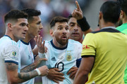 Lionel Messi of Argentina argues with Referee Mario Diaz de Vivar after being shown the red card during the Copa America Brazil 2019 Third Place match between Argentina and Chile at Arena Corinthians on July 06, 2019 in Sao Paulo, Brazil.