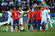 Arturo Vidal of Chile argues with Rodrigo De Paul and Sergio Aguero of Argentina during the Copa America Brazil 2019 Third Place match between Argentina and Chile at Arena Corinthians on July 06, 2019 in Sao Paulo, Brazil.